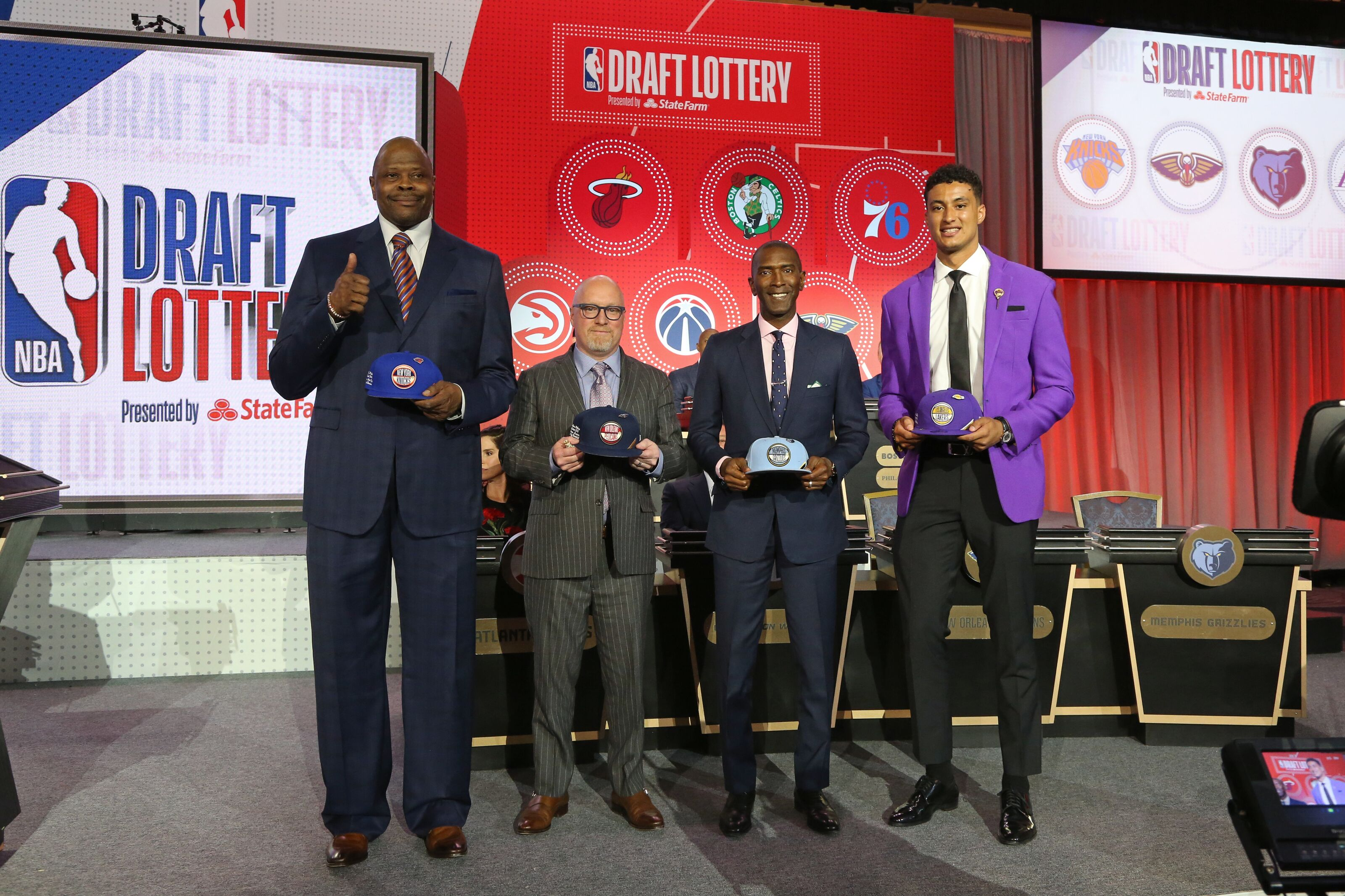 CHICAGO, IL - MAY 14: Patrick Ewing of the New York Knicks, David Griffin of the New Orleans Pelicans, Elliot Perry of the Memphis Grizzlies and Kyle Kuzma #0 of the Los Angeles Lakers pose for a photo on stage at the 2019 NBA Draft Lottery on May 14, 2019 at the Chicago Hilton in Chicago, Illinois. NOTE TO USER: User expressly acknowledges and agrees that, by downloading and/or using this photograph, user is consenting to the terms and conditions of the Getty Images License Agreement. Mandatory Copyright Notice: Copyright 2019 NBAE (Photo by Gary Dineen/NBAE via Getty Images)