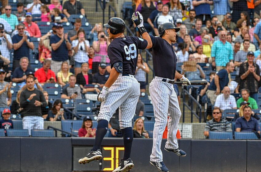 TAMPA, FL - MARCH 12: Aaron Judge #99 of the New York Yankees celebrates a homerun with Giancarlo Stanton #27 in the first inning during the spring training game against the Baltimore Orioles at Steinbrenner Field on March 12, 2019 in Tampa, Florida. (Photo by Mark Brown/Getty Images)