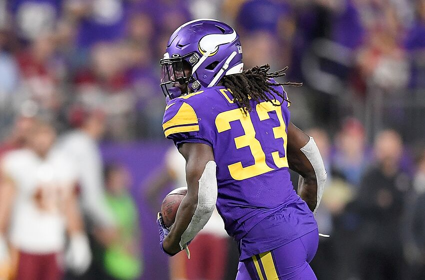 MINNEAPOLIS, MINNESOTA - OCTOBER 24: Running back Dalvin Cook #33 of the Minnesota Vikings runs against the defense of the Washington Redskins in the game at U.S. Bank Stadium on October 24, 2019 in Minneapolis, Minnesota. (Photo by Hannah Foslien/Getty Images)