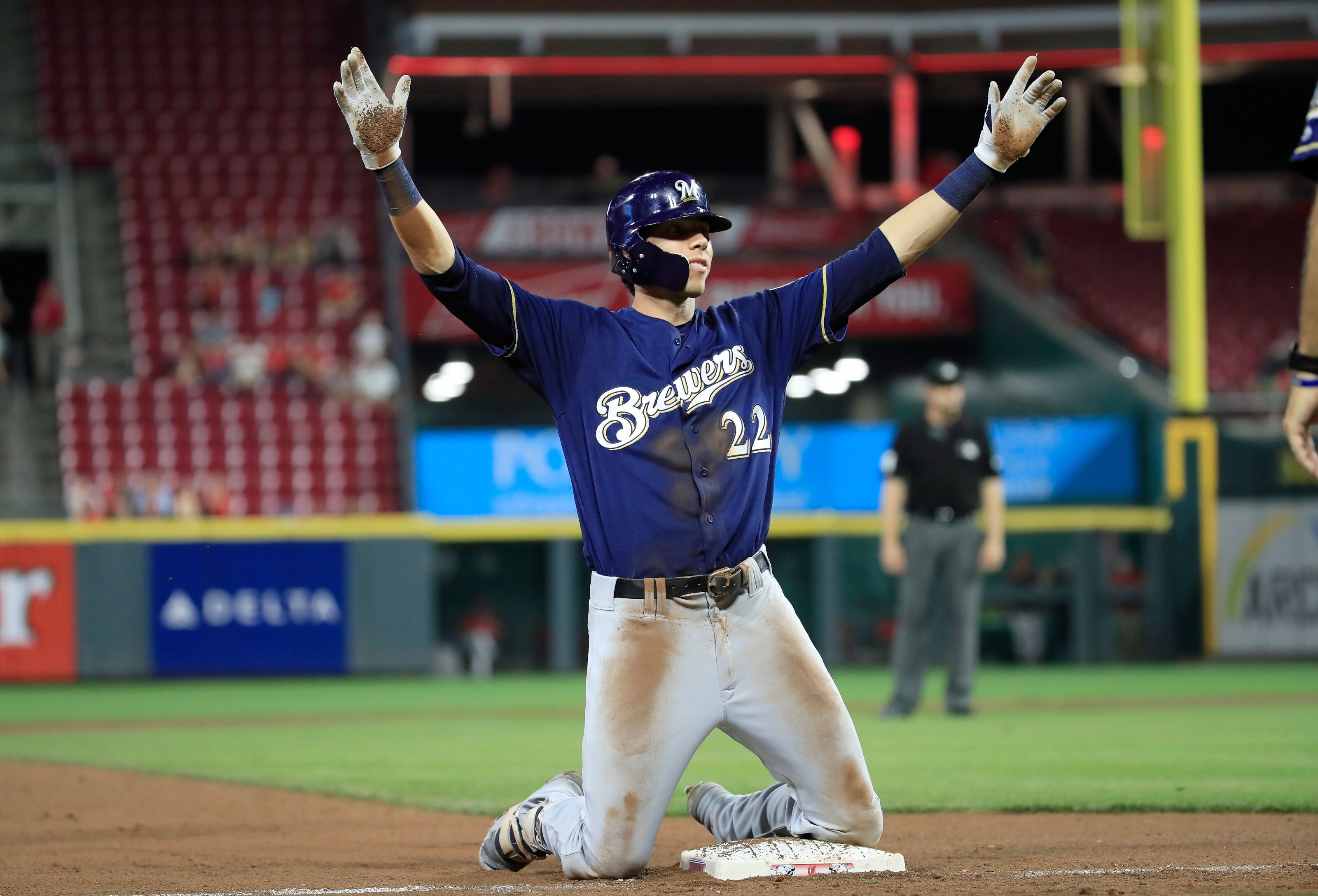 MLB Bets: CINCINNATI, OH - AUGUST 29: Christian Yelich #22 of the Milwaukee Brewers celebrates after hitting a tripple in the 7th inning against the Cincinnati Reds at Great American Ball Park on August 29, 2018 in Cincinnati, Ohio. (Photo by Andy Lyons/Getty Images)