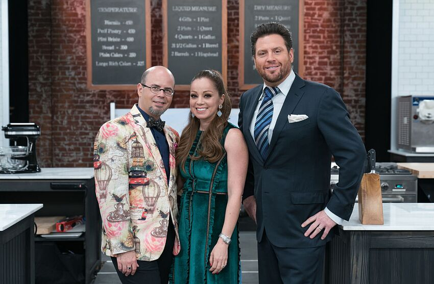 Judges Jason Smith and Marcela Valladolid with Host Scott Conant during the Skills Challenge, Mini Meringue Pies, Magnificent Meringue, as seen on Best Baker in America, Season 2. photo provided by Food Network