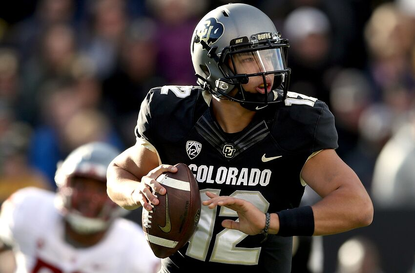 BOULDER, CO - NOVEMBER 10: Quarterback Steven Montez #12 of the Colorado Buffaloes is chased out of the pocket against the Washington State Cougars in the second quarter at Folsom Field on November 10, 2018 in Boulder, Colorado. (Photo by Matthew Stockman/Getty Images)