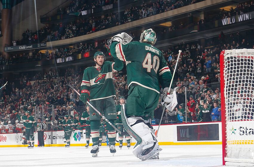 SAINT PAUL, MN - DECEMBER 23: Devan Dubnyk #40 and Carson Soucy #21 of the Minnesota Wild celebrate after defeating the Calgary Flames at the Xcel Energy Center on December 23, 2019 in Saint Paul, Minnesota. (Photo by Bruce Kluckhohn/NHLI via Getty Images)