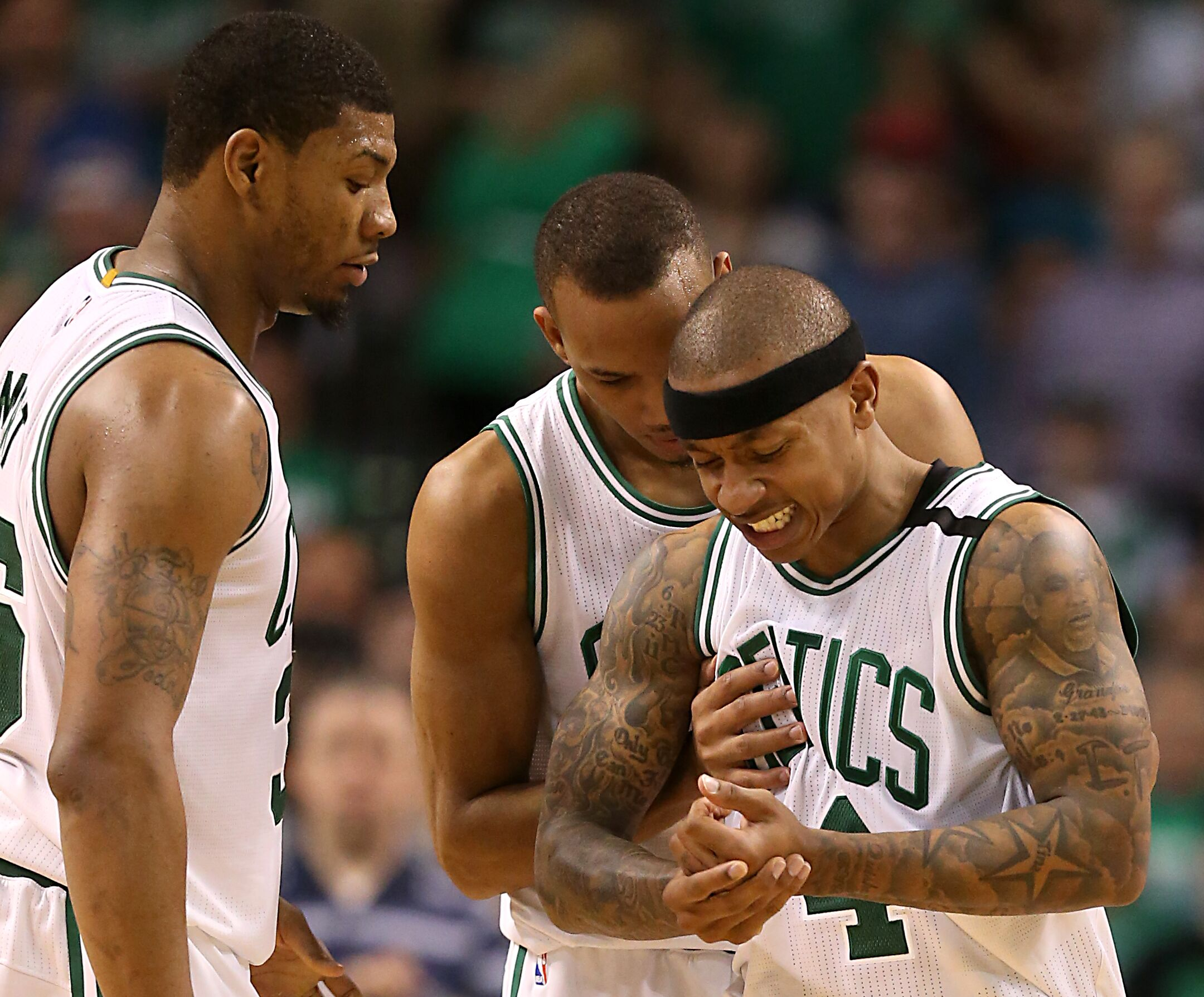 Boston April 16 Boston Celtics Marcus Smart And Avery Bradley Checks On Teammate Isaiah