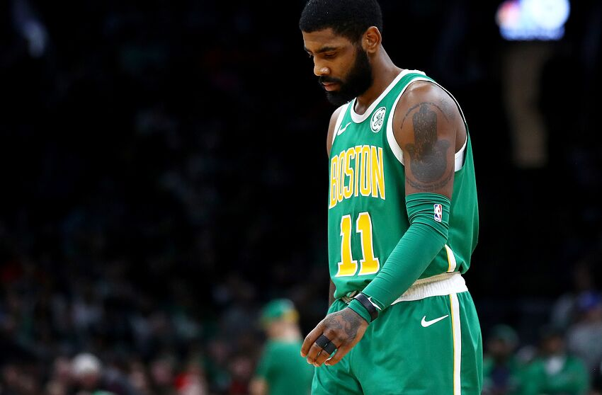 588c15fba68 BOSTON, MASSACHUSETTS - DECEMBER 25: Kyrie Irving #11 of the Boston Celtics  looks