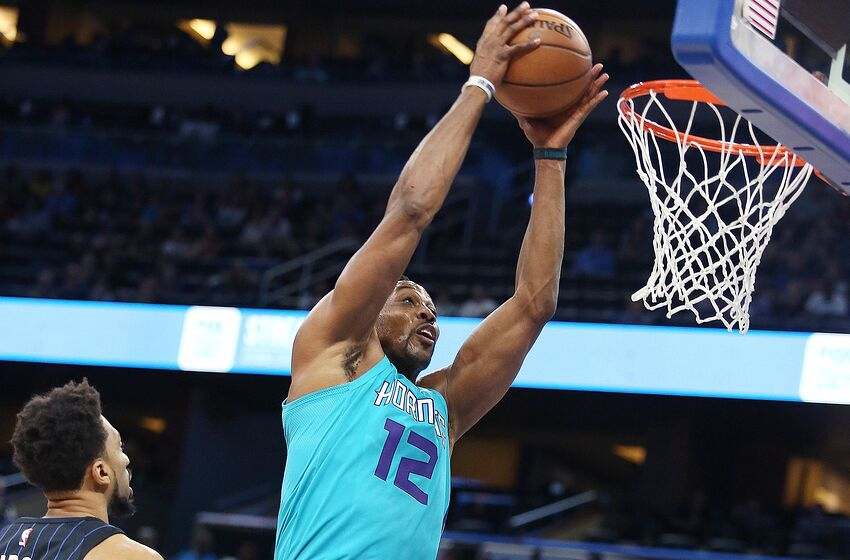 6a742c2f0aa The Charlotte Hornets  Dwight Howard (12) pulls down a rebound against the  Orlando