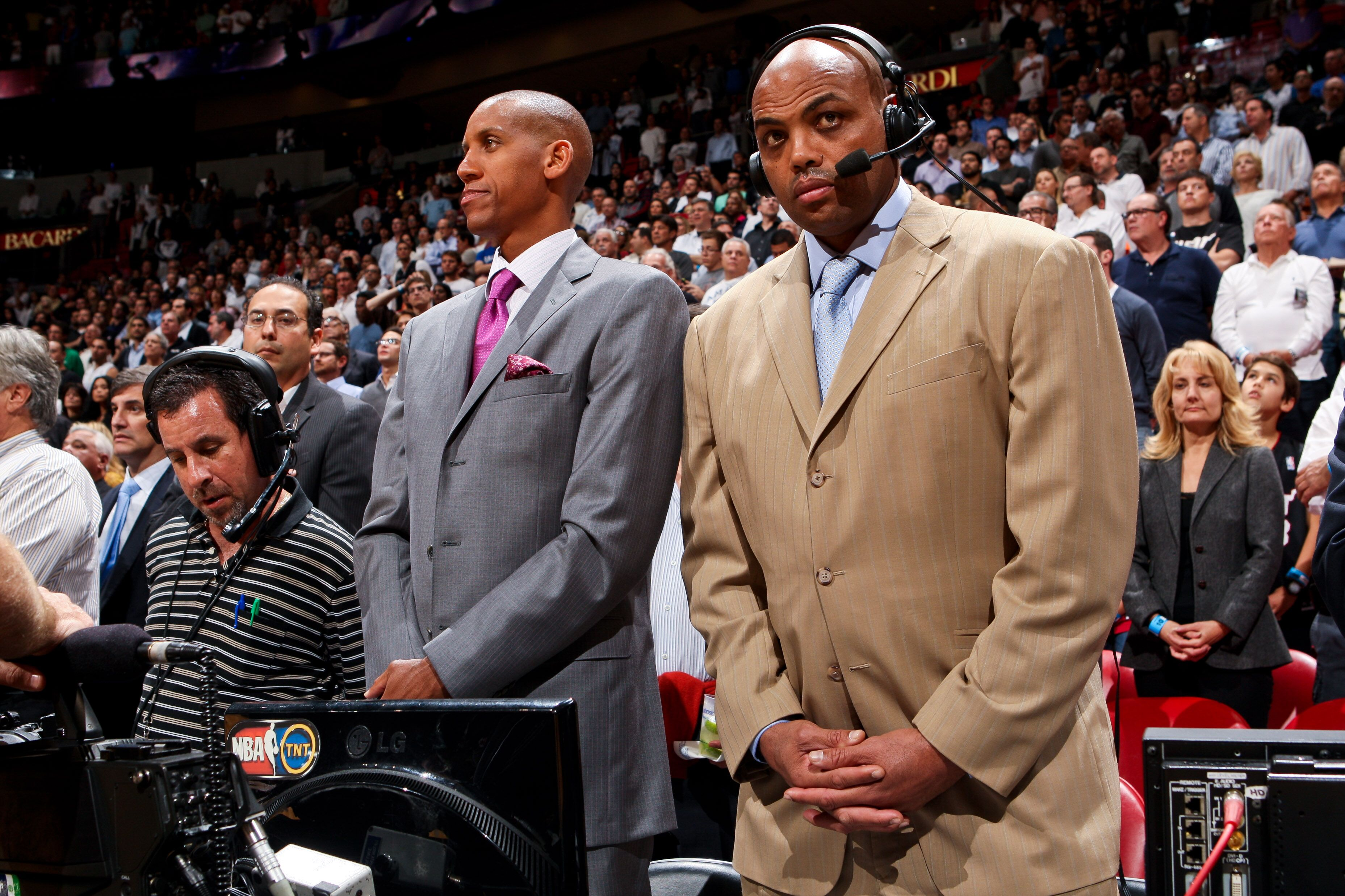 MIAMI, FL - NOVEMBER 29: Former NBA players and current TNT commentators Reggie Miller, left, and Charles Barkley listen to the National Anthem before a game between the San Antonio Spurs and Miami Heat against on November 29, 2012 at American Airlines Arena in Miami, Florida. NOTE TO USER: User expressly acknowledges and agrees that, by downloading and/or using this photograph, user is consenting to the terms and conditions of the Getty Images License Agreement. Mandatory copyright notice: Copyright NBAE 2012 (Photo by Issac Baldizon/NBAE via Getty Images)