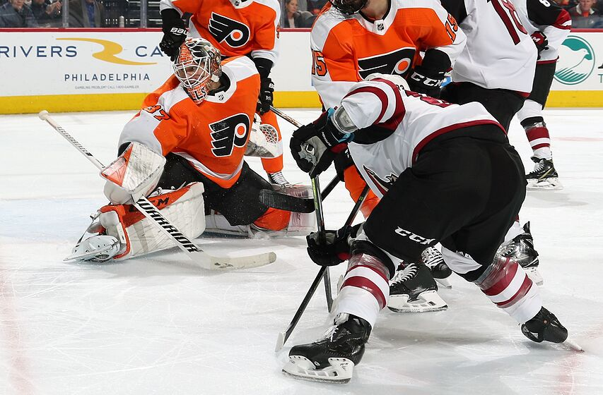 PHILADELPHIA, PA - DECEMBER 05: Conor Garland #83 of the Arizona Coyotes scores a third period goal against Brian Elliott #37 of the Philadelphia Flyers on December 5, 2019 at the Wells Fargo Center in Philadelphia, Pennsylvania. The Coyotes went on to defeat the Flyers 3-1. (Photo by Len Redkoles/NHLI via Getty Images)