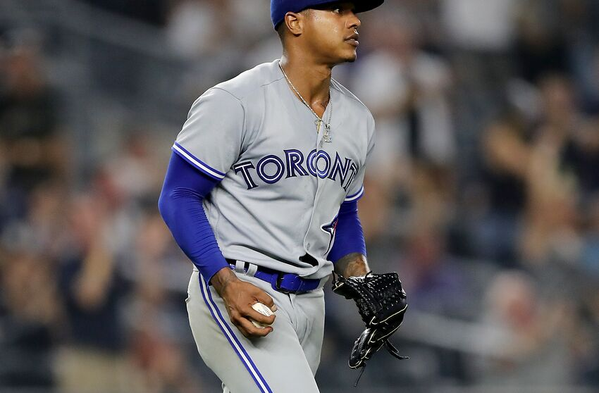 NEW YORK, NY - AUGUST 17: Marcus Stroman #6 of the Toronto Blue Jays reacts after giving up a three run home run to Neil Walker of the New York Yankees in the fourth inning at Yankee Stadium on August 17, 2018 in the Bronx borough of New York City. (Photo by Elsa/Getty Images)