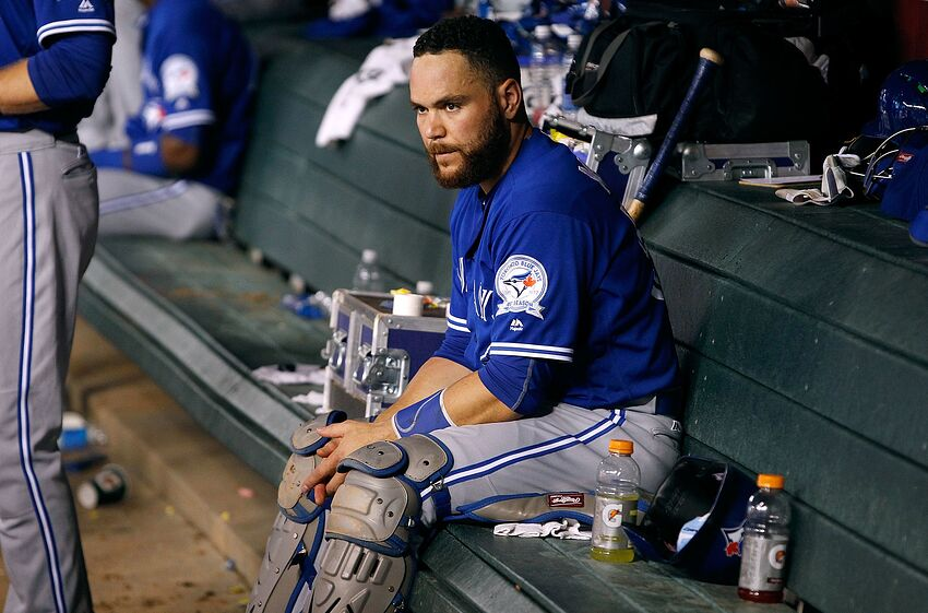 PHOENIX, AZ - JULY 19: Russell Martin #55 of the Toronto Blue Jays looks on from the dugout during the seventh inning of a MLB interleague game against the Arizona Diamondbacks at Chase Field on July 19, 2016 in Phoenix, Arizona. (Photo by Ralph Freso/Getty Images)