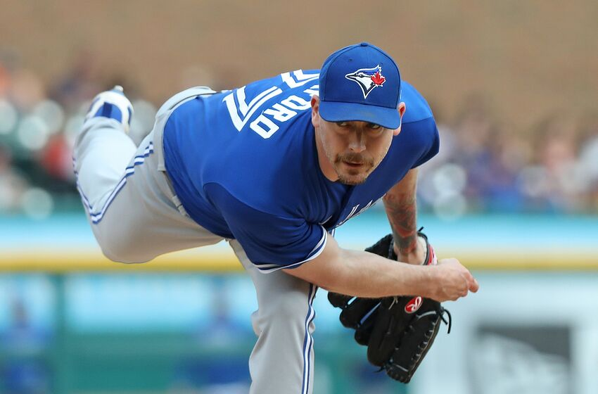 DETROIT, MI - JUNE 2: John Axford #77 of the Toronto Blue Jays pitches during the sixth inning of the game against the Detroit Tigers at Comerica Park on June 2, 2018 in Detroit, Michigan. (Photo by Leon Halip/Getty Images)