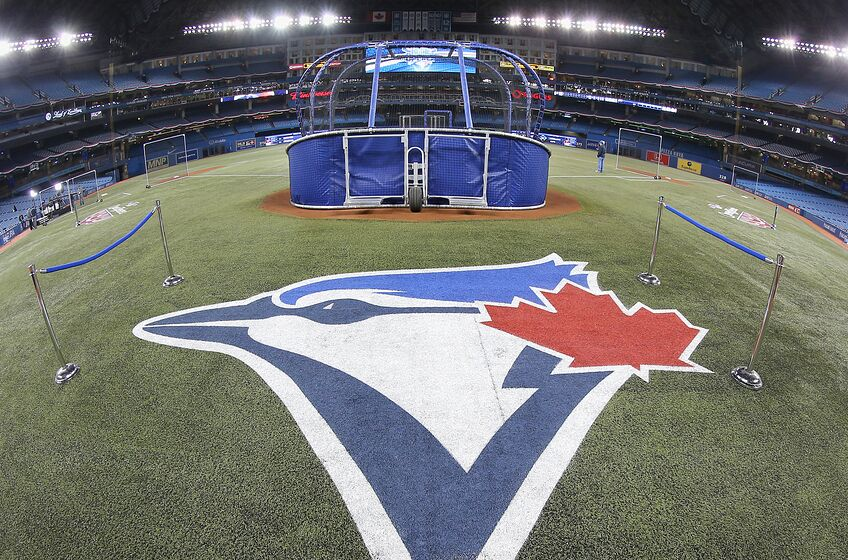 TORONTO, CANADA - APRIL 4: The Toronto Blue Jays logo painted on the field during batting practice before the Toronto Blue Jays home opener prior to the start of their MLB game against the New York Yankees on April 4, 2014 at Rogers Centre in Toronto, Ontario, Canada. (Photo by Tom Szczerbowski/Getty Images)