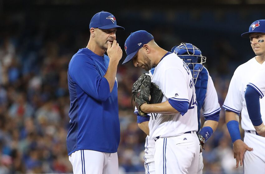 TORONTO, ON - JULY 26: Marco Estrada #25 of the Toronto Blue Jays is visited on the mound by pitching coach Pete Walker #40 in the fifth inning during MLB game action against the Oakland Athletics at Rogers Centre on July 26, 2017 in Toronto, Canada. (Photo by Tom Szczerbowski/Getty Images)