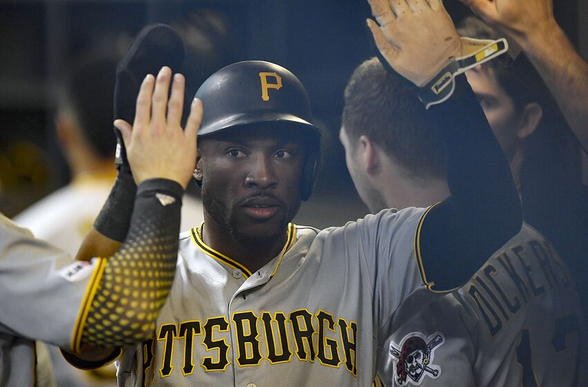 MILWAUKEE, WISCONSIN - JUNE 30: Starling Marte #6 of the Pittsburgh Pirates celebrates in the dugout with teammates after scoring in the first inning against the Milwaukee Brewers at Miller Park on June 30, 2019 in Milwaukee, Wisconsin. (Photo by Quinn Harris/Getty Images)