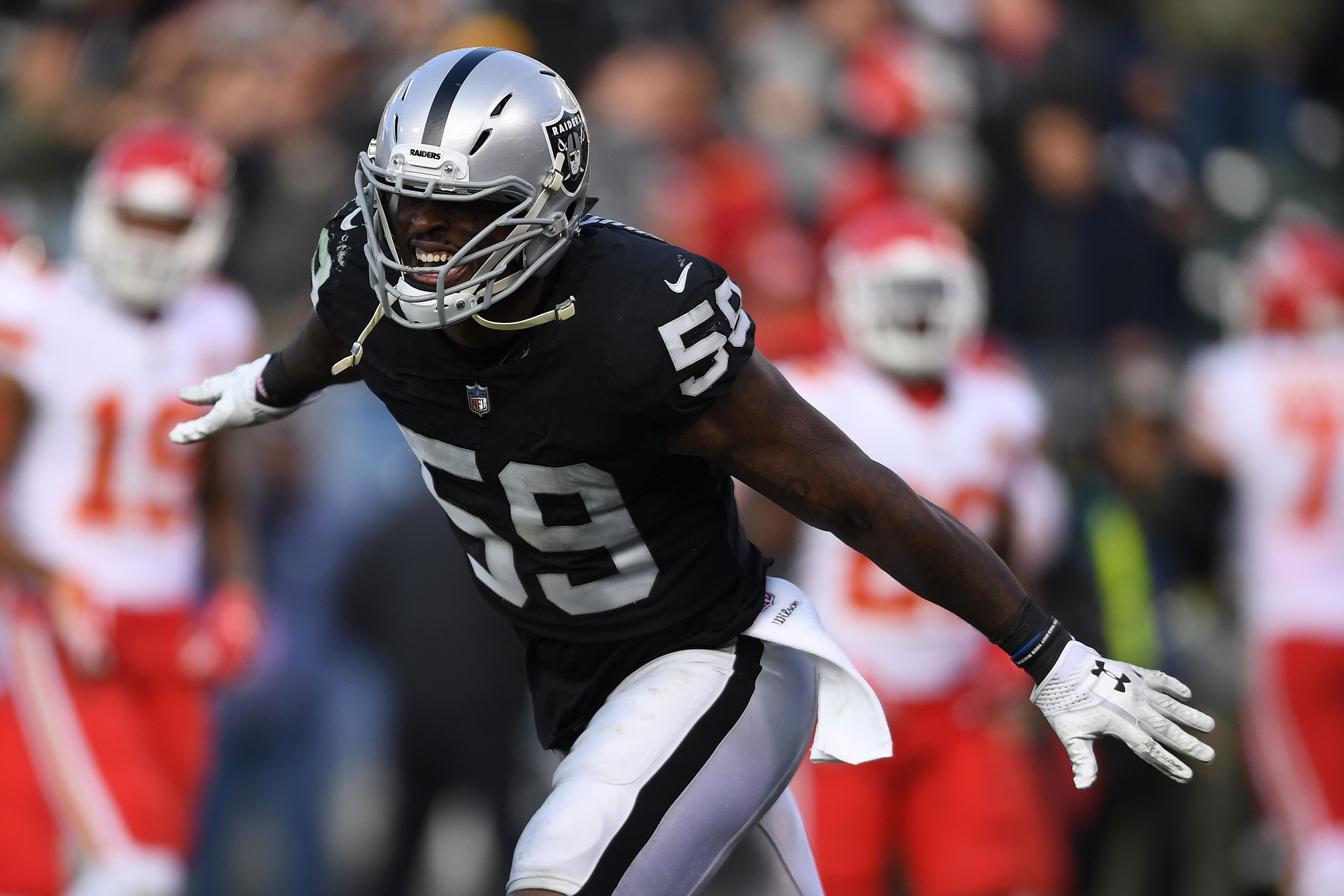 OAKLAND, CA - DECEMBER 02: Tahir Whitehead #59 of the Oakland Raiders celebrates after a play against the Kansas City Chiefs during their NFL game at Oakland-Alameda County Coliseum on December 2, 2018 in Oakland, California. (Photo by Thearon W. Henderson/Getty Images)