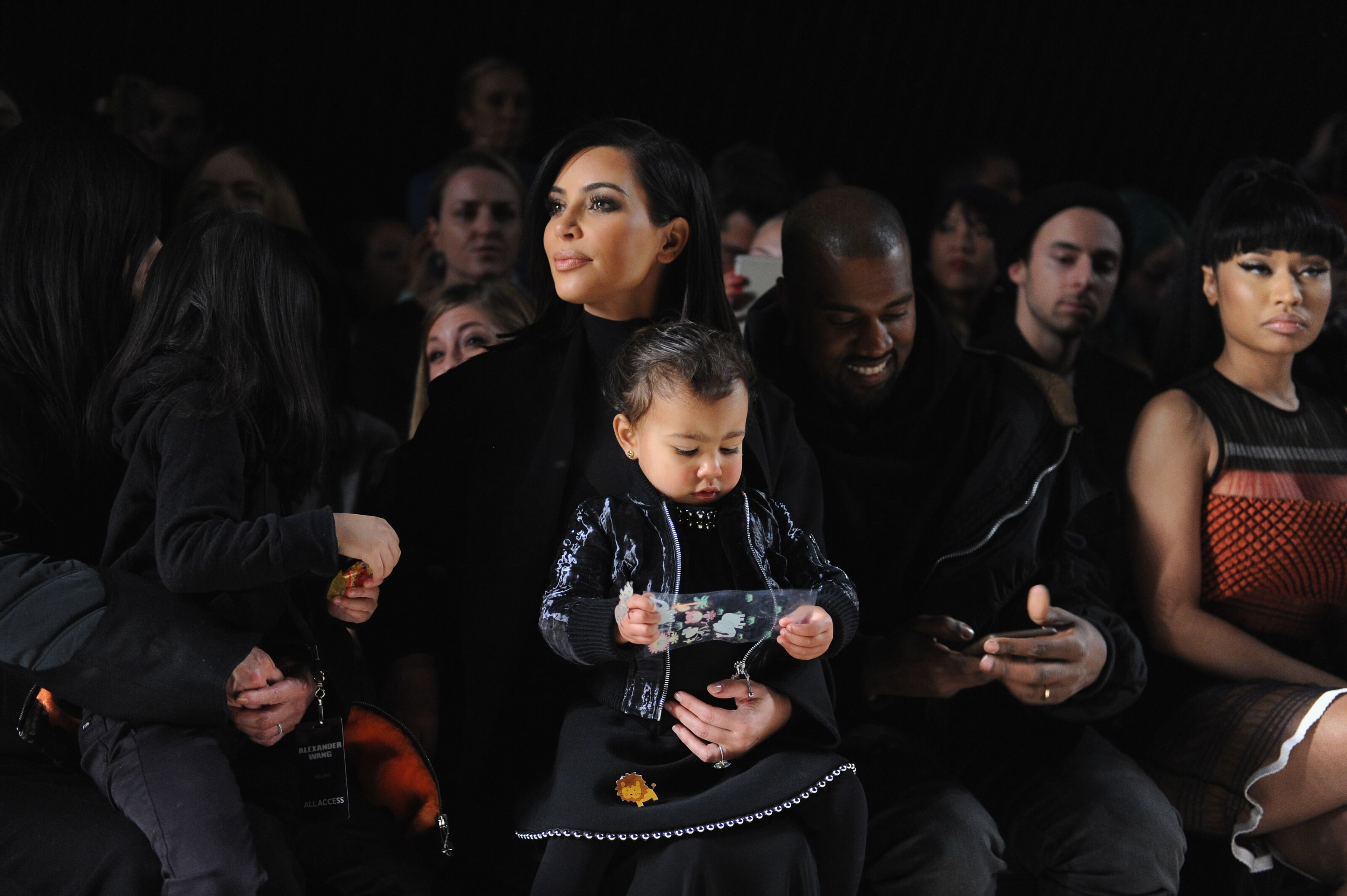 NEW YORK, NY - FEBRUARY 14: (L-R) Kim Kardashian, North West, Kanye West and Nicki Minaj attend the Alexander Wang Fashion Show during Mercedes-Benz Fashion Week Fall 2015 at Pier 94 on February 14, 2015 in New York City. (Photo by Craig Barritt/Getty Images)