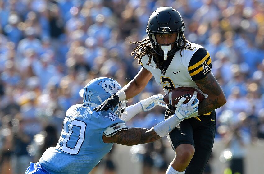 CHAPEL HILL, NORTH CAROLINA - SEPTEMBER 21: Greg Ross #10 of the North Carolina Tar Heels tackles Darrynton Evans #3 of the Appalachian State Mountaineers during the first half of their game at Kenan Stadium on September 21, 2019 in Chapel Hill, North Carolina. (Photo by Grant Halverson/Getty Images)