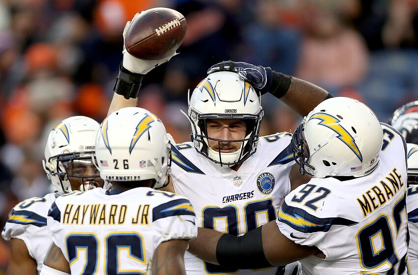 DENVER, COLORADO - DECEMBER 30: Joey Bosa #99 of the Los Angeles Chargers celebrates a fumble recovery against the Denver Broncos at Broncos Stadium at Mile High on December 30, 2018 in Denver, Colorado. (Photo by Matthew Stockman/Getty Images)