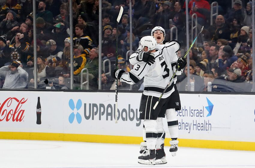 BOSTON, MASSACHUSETTS - DECEMBER 17: Matt Roy #3 of the Los Angeles Kings celebrates with Nikolai Prokhorkin #74 after scoring a goal against the Boston Bruins during the third period at TD Garden on December 17, 2019 in Boston, Massachusetts. (Photo by Maddie Meyer/Getty Images)