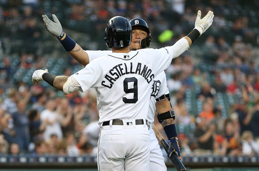 DETROIT, MI - JUNE 27: Nicholas Castellanos #9 of the Detroit Tigers is congratulated by teammate Miguel Cabrera #24 after hitting a solo home run to center field during the fifth inning of the game against the Washington Nationals at Comerica Park on June 28, 2019 in Detroit, Michigan. (Photo by Leon Halip/Getty Images)