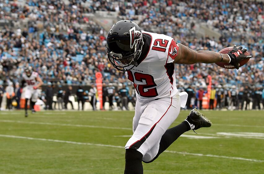 CHARLOTTE, NORTH CAROLINA - DECEMBER 23: Mohamed Sanu #12 of the Atlanta Falcons runs for a touchdown against the Carolina Panthers in the third quarter during their game at Bank of America Stadium on December 23, 2018 in Charlotte, North Carolina. (Photo by Grant Halverson/Getty Images)