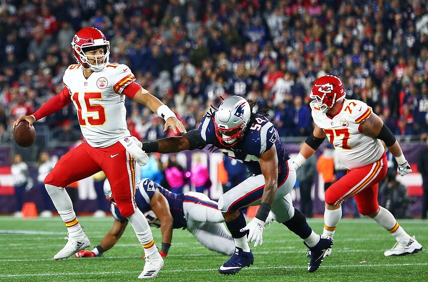 FOXBOROUGH, MA - OCTOBER 14: Patrick Mahomes #15 of the Kansas City Chiefs looks to pass in the second quarter of a game against the New England Patriots at Gillette Stadium on October 14, 2018 in Foxborough, Massachusetts. (Photo by Adam Glanzman/Getty Images)