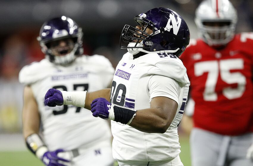 INDIANAPOLIS, INDIANA - DECEMBER 01: Jordan Thompson #99 of the Northwestern Wildcats reacts after a sack against the Ohio State Buckeyes in the fourth quarter at Lucas Oil Stadium on December 01, 2018 in Indianapolis, Indiana. (Photo by Joe Robbins/Getty Images)