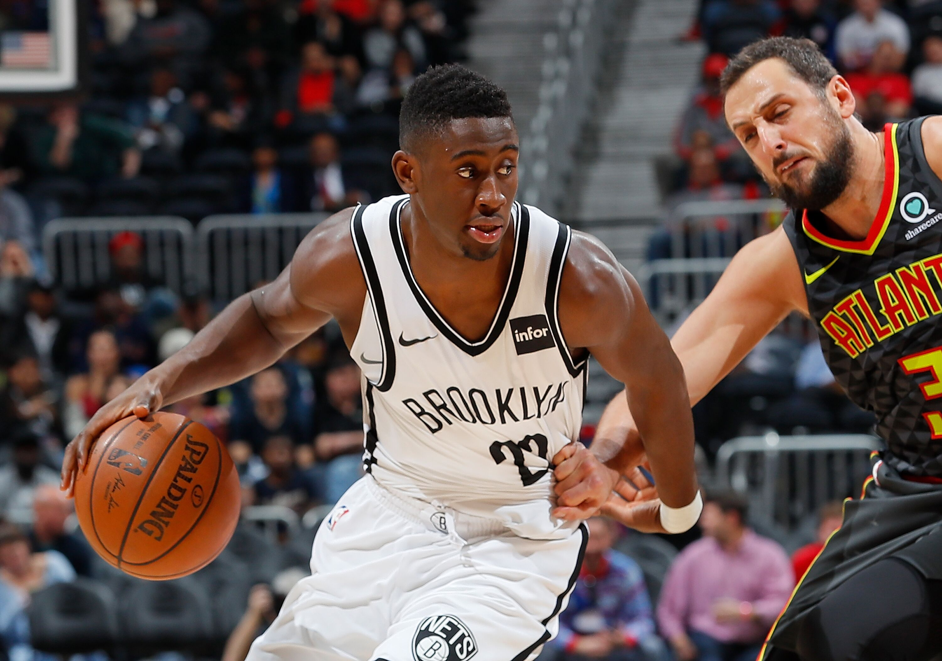 ATLANTA, GA - DECEMBER 04: Caris LeVert #22 of the Brooklyn Nets drives against Marco Belinelli #3 of the Atlanta Hawks at Philips Arena on December 4, 2017 in Atlanta, Georgia. NOTE TO USER: User expressly acknowledges and agrees that, by downloading and or using this photograph, User is consenting to the terms and conditions of the Getty Images License Agreement. (Photo by Kevin C. Cox/Getty Images)