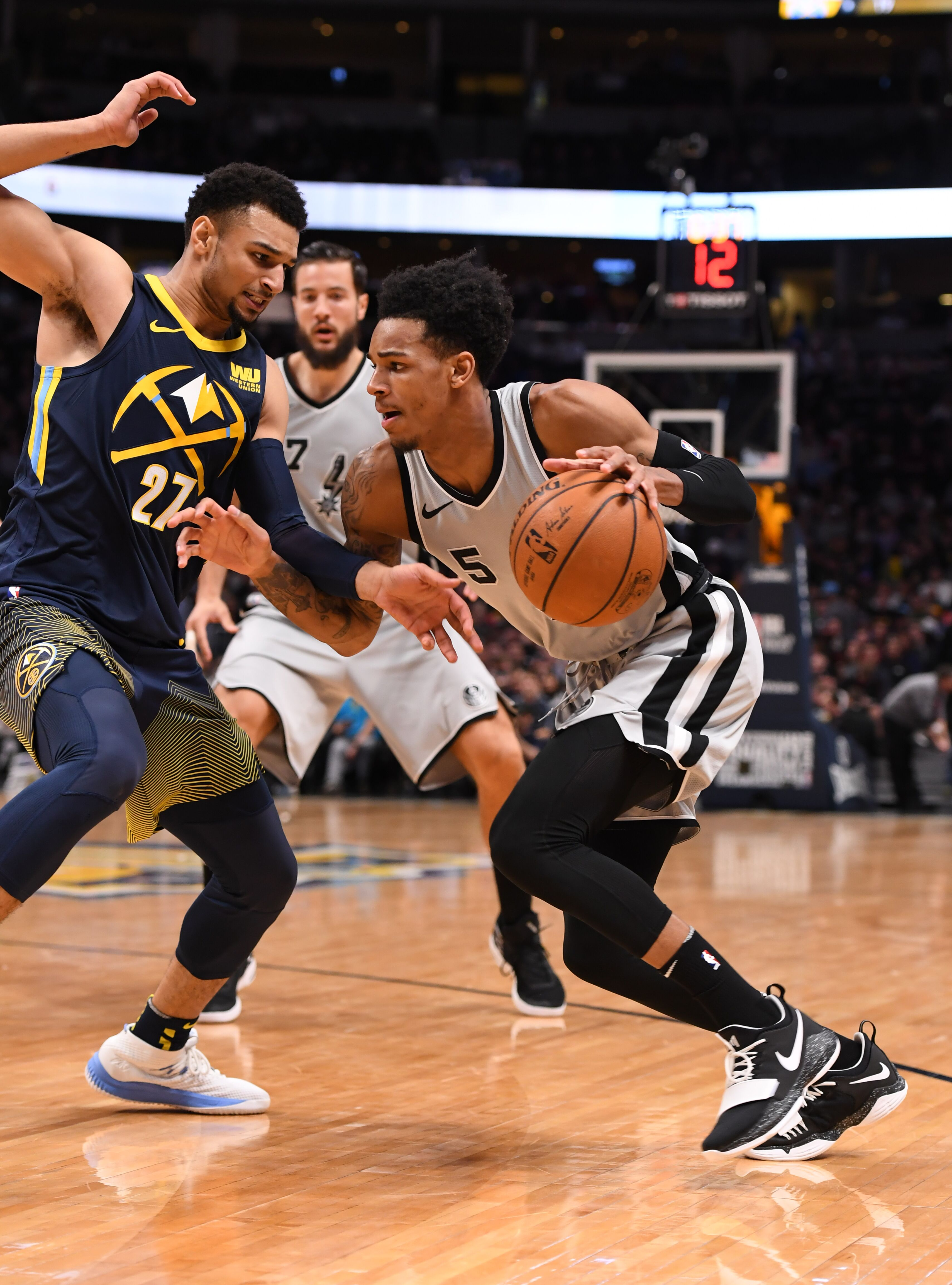 DENVER, CO - FEBRUARY 13: San Antonio Spurs guard Dejounte Murray (5) drives on Denver Nuggets guard Jamal Murray (27) during the first quarter on February 13, 2018 at Pepsi Center. (Photo by John Leyba/The Denver Post via Getty Images)