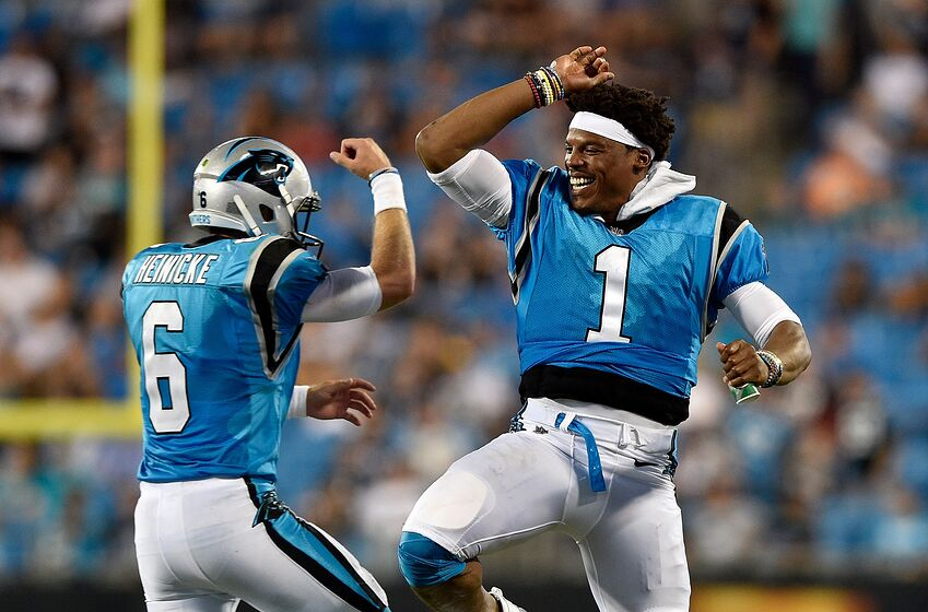 19126f8a CHARLOTTE, NC - AUGUST 17: Cam Newton #1 and teammate Taylor Heinicke #