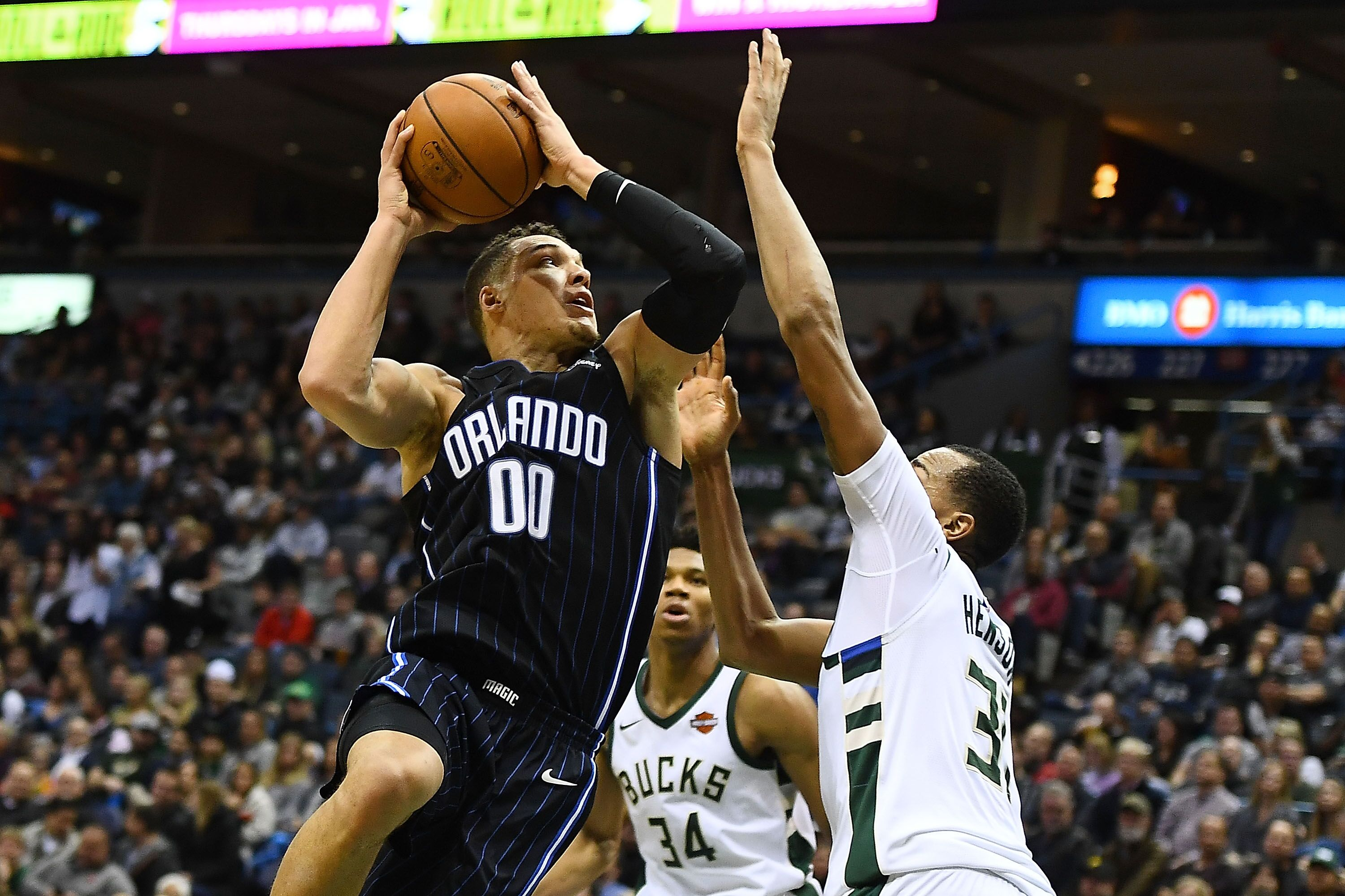 MILWAUKEE, WI - JANUARY 10: Aaron Gordon #00 of the Orlando Magic drives to the basket against John Henson #31 of the Milwaukee Bucks during a game at the Bradley Center on January 10, 2018 in Milwaukee, Wisconsin. NOTE TO USER: User expressly acknowledges and agrees that, by downloading and or using this photograph, User is consenting to the terms and conditions of the Getty Images License Agreement. (Photo by Stacy Revere/Getty Images)
