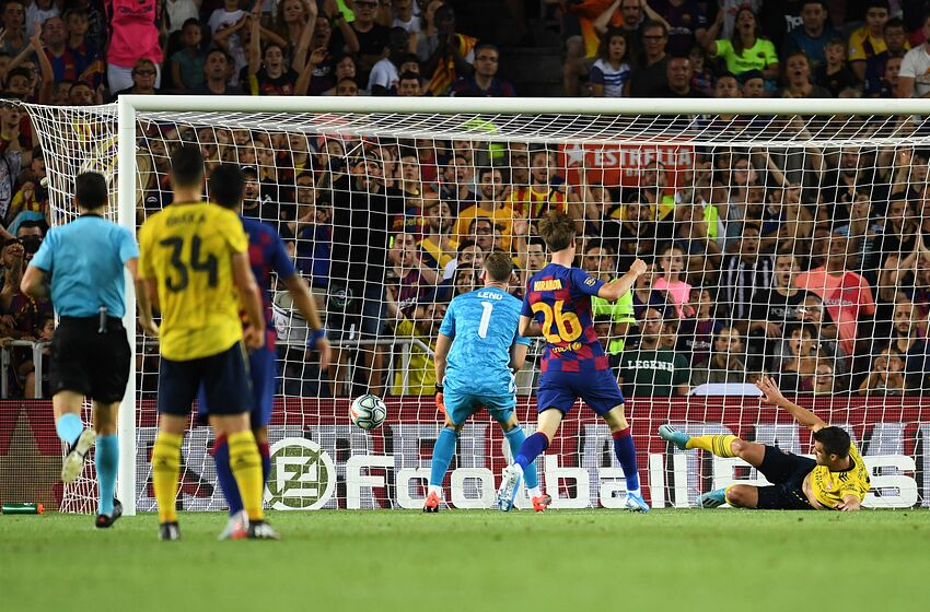 BARCELONA, SPAIN - AUGUST 04: Bernd Leno (1) and Sokratis Papastathopoulos of Arsenal (R) faisl to stop the ball as Ainsley Maitland-Niles of Arsenal scores an own goal for Barcelona's first goal during the Joan Gamper Trophy pre-season friendly match between FC Barcelona and Arsenal at Nou Camp on August 04, 2019 in Barcelona, Spain. (Photo by David Ramos/Getty Images)