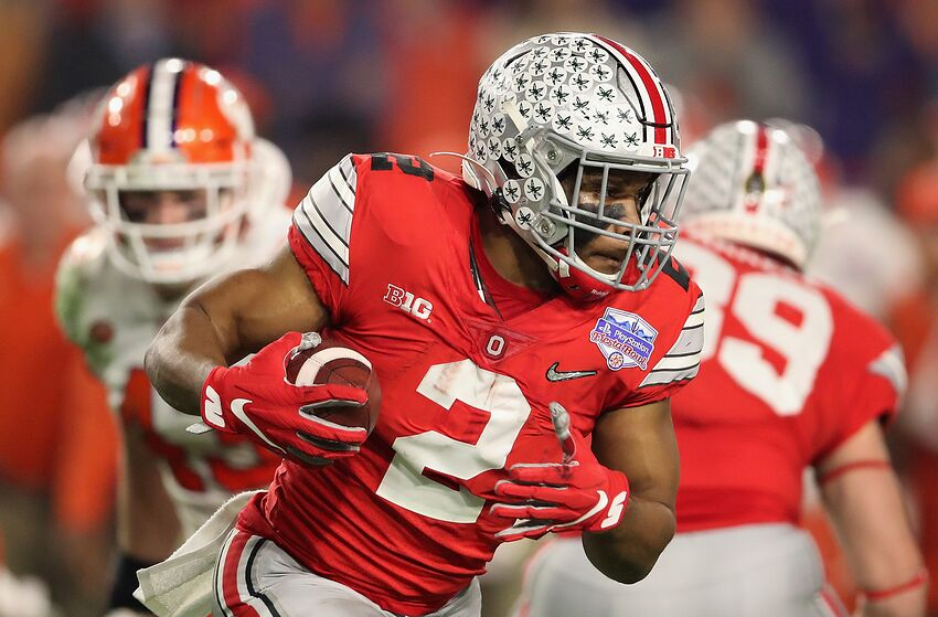 GLENDALE, ARIZONA - DECEMBER 28: Running back J.K. Dobbins #2 of the Ohio State Buckeyes rushes the football against the Clemson Tigers during the PlayStation Fiesta Bowl at State Farm Stadium on December 28, 2019 in Glendale, Arizona. The Tigers defeated the Buckeyes 29-23. (Photo by Christian Petersen/Getty Images)