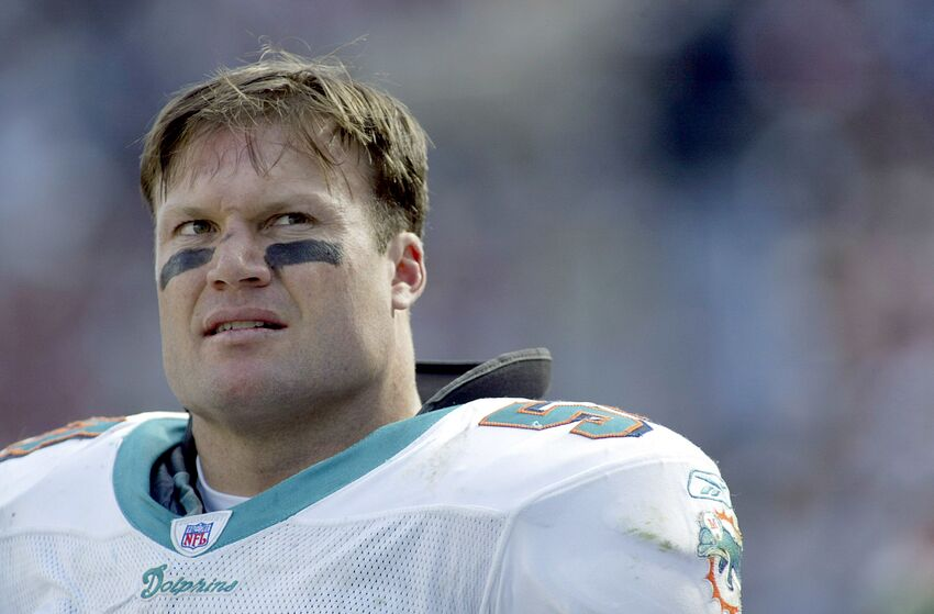 FOXBORO, MA - OCTOBER 10: Zach Thomas #54 of the Miami Dolphins stands on the sideline during a game against the New England Patriots on October 10, 2004 at Gillette Stadium in Foxboro, Massachusetts.(Photo by Rick Stewart/Getty Images)