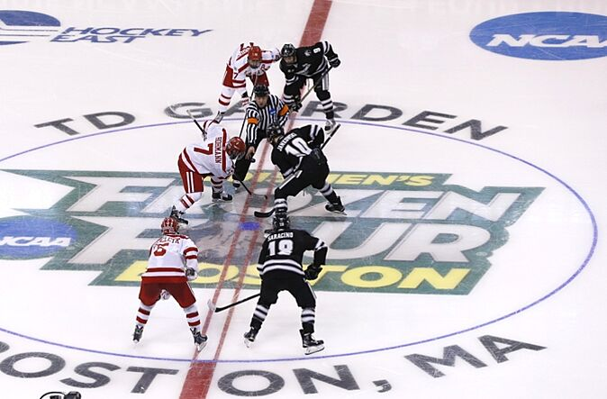 Apr 11, 2015; Boston, MA, USA; Boston University Terriers forward Cason Hohmann (7) and Providence College Friars forward Mark Jankowski (10) battle for the face off to start the second period in the championship game of the Frozen Four college ice hockey tournament at TD Garden. Mandatory Credit: Greg M. Cooper-USA TODAY Sports