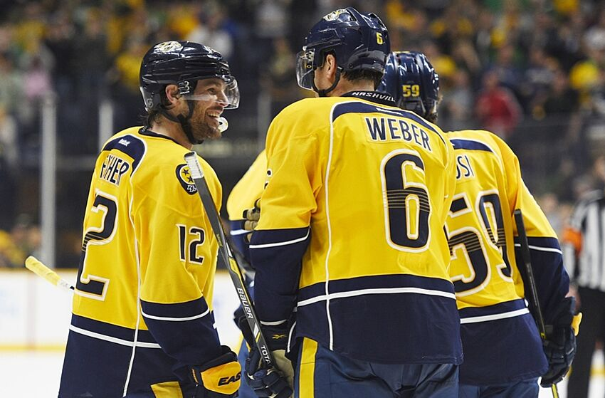 Mar 17, 2016; Nashville, TN, USA; Nashville Predators center Mike Fisher (12) celebrates with defenseman Shea Weber (6) after a goal during the third period against the New York Islanders at Bridgestone Arena. The Predators won 4-2. Mandatory Credit: Christopher Hanewinckel-USA TODAY Sports