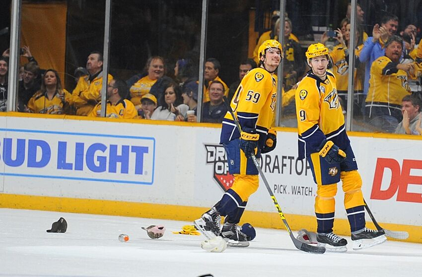 ecd99d34973 Nashville Predators left winger Filip Forsberg (9) celebrates with  defenseman Roman Josi (59