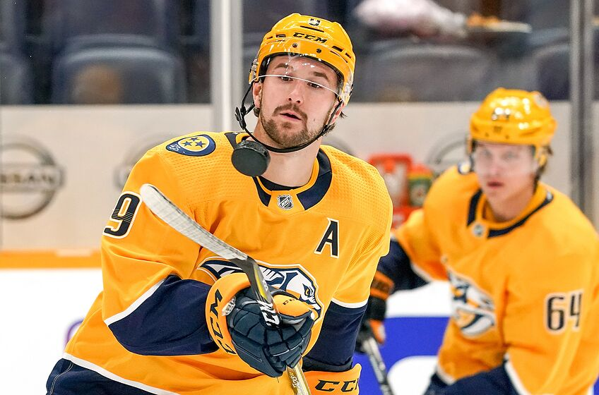 NASHVILLE, TN - NOVEMBER 21: Filip Forsberg #9 of the Nashville Predators tosses a puck during warmups prior to an NHL game against the Vancouver Canucks at Bridgestone Arena on November 21, 2019 in Nashville, Tennessee. (Photo by John Russell/NHLI via Getty Images)