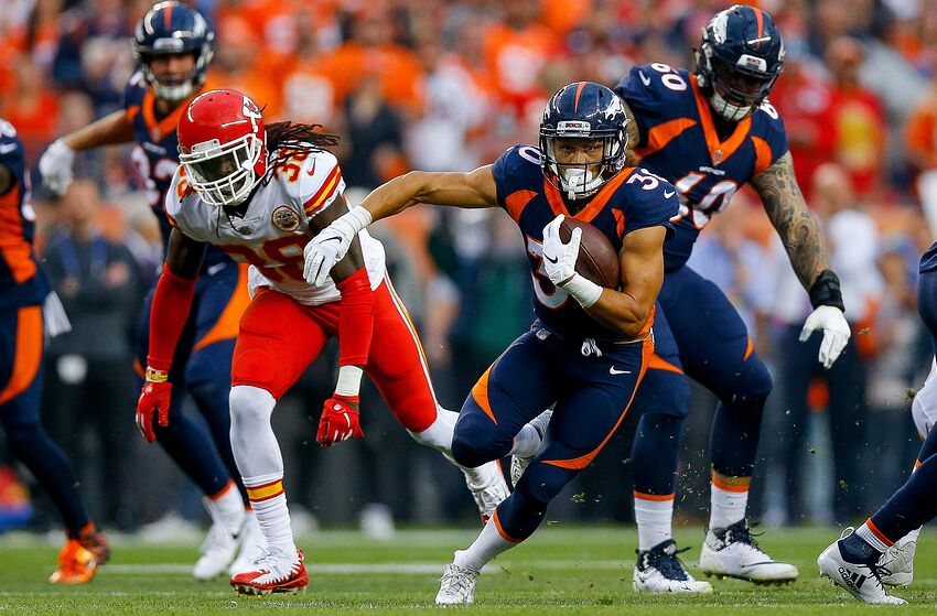 DENVER, CO - OCTOBER 1: Running back Phillip Lindsay #30 of the Denver Broncos rushes against the Kansas City Chiefs in the first quarter of a game at Broncos Stadium at Mile High on October 1, 2018 in Denver, Colorado. (Photo by Justin Edmonds/Getty Images)