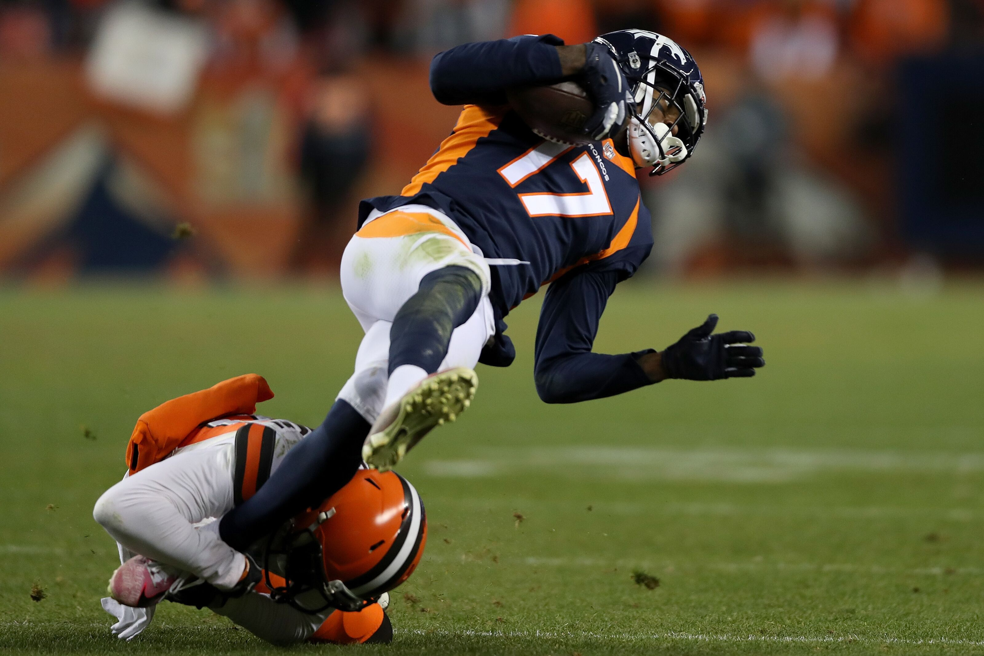 DENVER, COLORADO - DECEMBER 15: Briean Boddy-Calhoun #20 of the Cleveland Browns tackles DaeSean Hamilton #17 of the Denver Broncos at Broncos Stadium at Mile High on December 15, 2018 in Denver, Colorado. (Photo by Matthew Stockman/Getty Images)