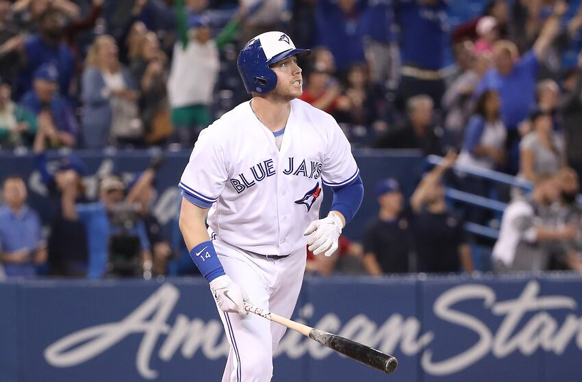 TORONTO, ON - SEPTEMBER 20: Justin Smoak #14 of the Toronto Blue Jays watches as he hits a game-winning solo home run in the ninth inning during MLB game action against the Tampa Bay Rays at Rogers Centre on September 20, 2018 in Toronto, Canada. (Photo by Tom Szczerbowski/Getty Images)