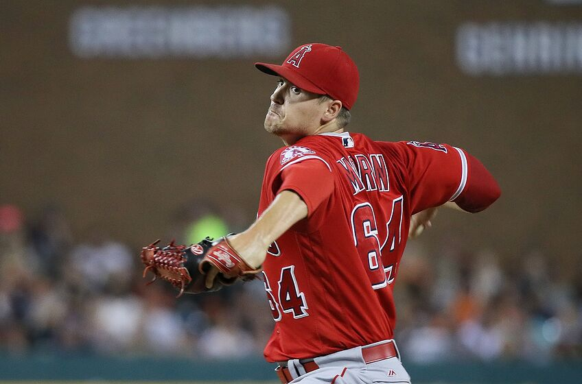 DETROIT, MI - AUGUST 27: Mike Morin #64 of the Los Angeles Angels pitches in the seventh inning of the game against the Detroit Tigers on August 27, 2016 at Comerica Park in Detroit, Michigan. (Photo by Leon Halip/Getty Images)