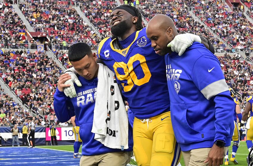 LOS ANGELES, CA - DECEMBER 29: Michael Brockers #90 of the Los Angeles Rams is helped off the field after an injury while playing the Arizona Cardinals in the second half at Los Angeles Memorial Coliseum on December 29, 2019 in Los Angeles, California. (Photo by John McCoy/Getty Images)