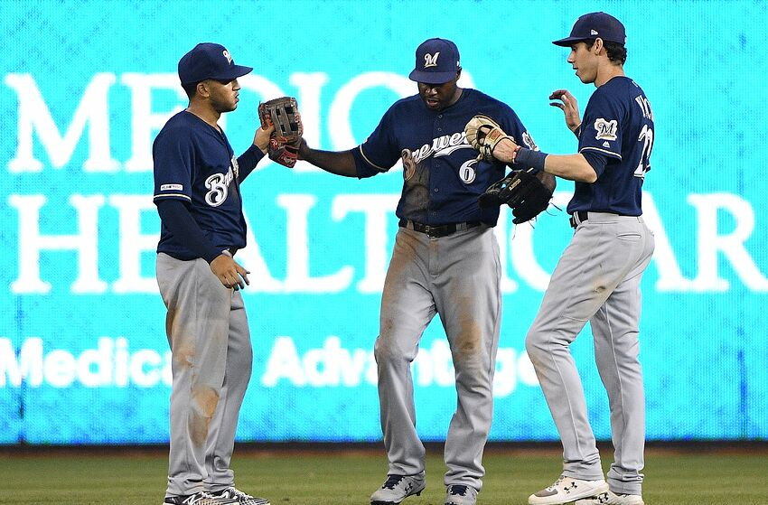 MIAMI, FLORIDA - SEPTEMBER 09: Trent Grisham #2, Lorenzo Cain #6, and Christian Yelich #22 of the Milwaukee Brewers celebrate the win against the Miami Marlins at Marlins Park on September 09, 2019 in Miami, Florida. (Photo by Mark Brown/Getty Images)