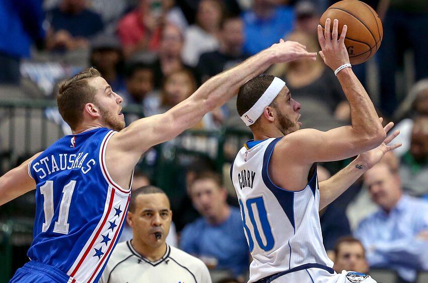Dallas Mavericks guard Seth Curry (30) gets off a shot past Philadelphia  76ers guard 3d8b559a0