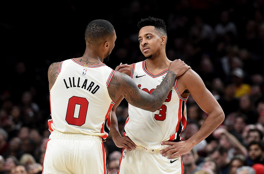 PORTLAND, OREGON - DECEMBER 06: Damian Lillard #0 of the Portland Trail Blazers tries to speak with CJ McCollum #3 after McCollum drew a technical foul during the second half of the game against the Los Angeles Lakers at Moda Center on December 06, 2019 in Portland, Oregon. The Lakers won 136-113. NOTE TO USER: User expressly acknowledges and agrees that, by downloading and or using this photograph, User is consenting to the terms and conditions of the Getty Images License Agreement. (Photo by Steve Dykes/Getty Images)