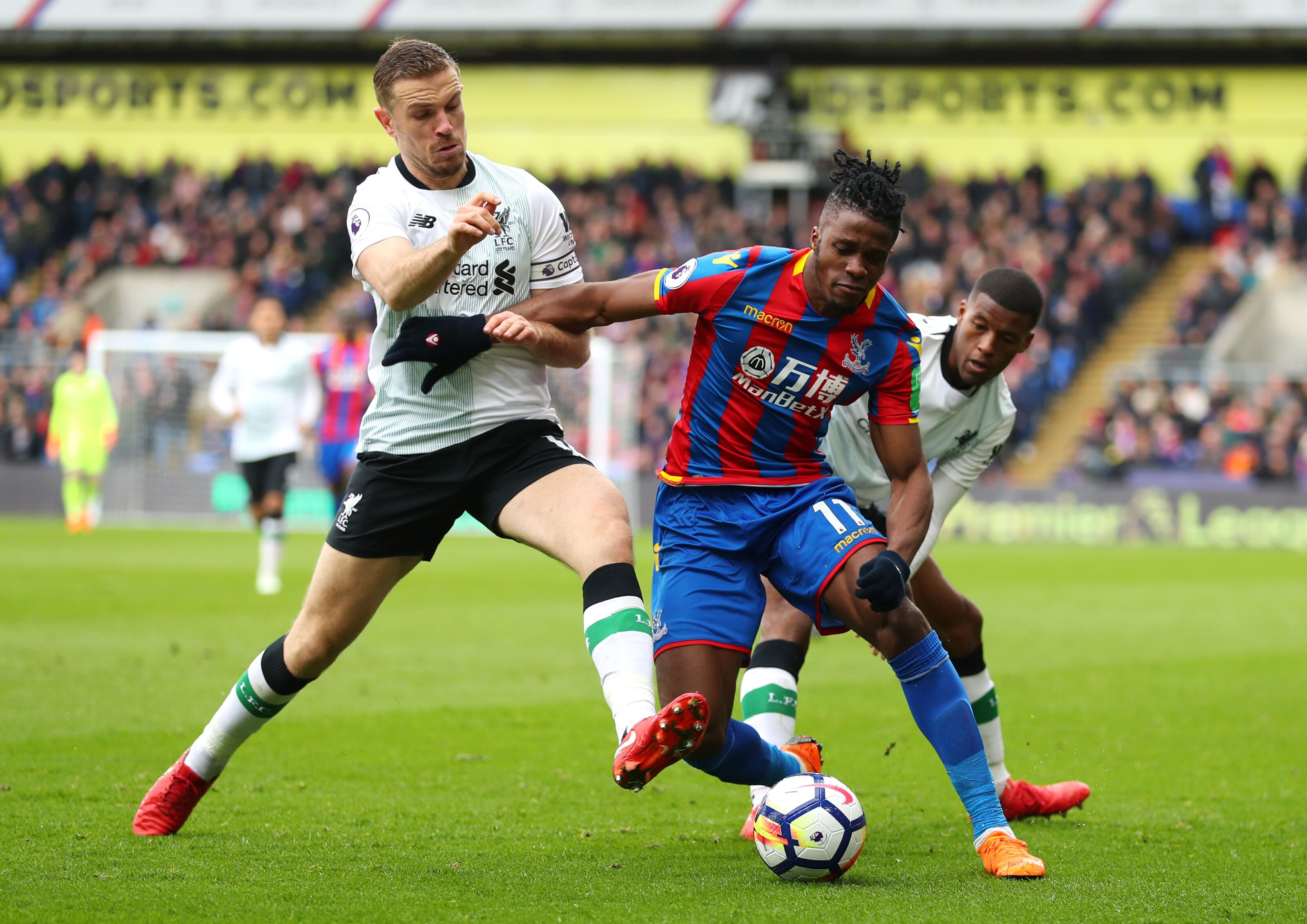 London England March 31 Wilfried Zaha Of Crystal Palace Is Challenged By Jordan