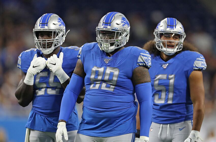 DETROIT, MI - AUGUST 8: Trey Flowers #90, Eric Lee #55 and Jahlani Tavai #51 of the Detroit Lions line up during the preseason game against the New England Patriots at Ford Field on August 8, 2019 in Detroit, Michigan. New England defeated Detroit 31-3. (Photo by Leon Halip/Getty Images)