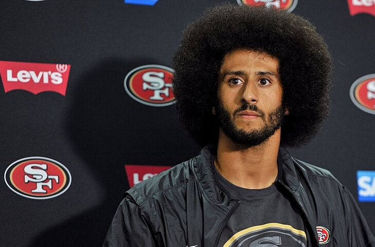 Sep 1, 2016; San Diego, CA, USA; San Francisco 49ers quarterback Colin Kaepernick (7) looks on during a press conference following the game against the San Diego Chargers at Qualcomm Stadium. San Francisco won 31-21. Mandatory Credit: Orlando Ramirez-USA TODAY Sports