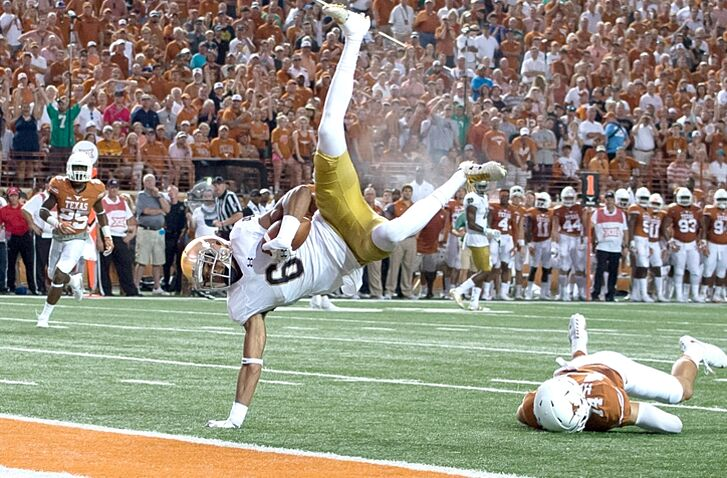 Sep 4, 2016; Austin, TX, USA; Notre Dame Fighting Irish wide receiver Equanimeous St. Brown (6) flips into the end zone for a touchdown in front of Texas Longhorns safety Dylan Haines (14) in the second quarter at Darrell K. Royal-Texas Memorial Stadium. Mandatory Credit: Matt Cashore-USA TODAY Sports
